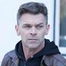 Ian Tracey en el papel de Tank