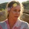 Rebecca Romijn en el papel de Lauren Halsey