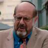 Fred Melamed en el papel de Joel