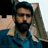Rahul Kohli en el papel de Sheriff Hassan