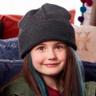 Quinn Copeland en el papel de Izzy